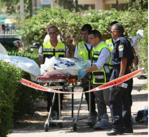 Police and ZAKA workers at the scene of a double murder drive-by in Petah Tikva in last June, which remains unsolved (Photo: Ben Hartman)