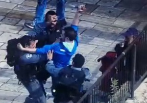 Muhammed Ali stabbing cops during the attack at Damascus Gate. (CCTV screenshot)