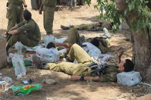 Soldiers from the 13th battalion of the Golani Brigade relax in a staging area near the Gaza border several hours before the APC disaster. (Ben Hartman)