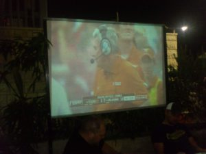 Watching the 2012 OU game on the projector outside Mike's Place on the Tel Aviv seafront. Those guys never turned around to look at the screen, and we lost 63-21.